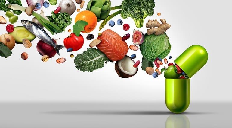 Vitamintablette mit Früchten und Gemüse