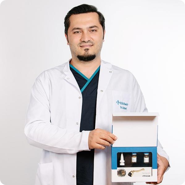 Doutor Balwi segura um kit NEO FUE da Elithair