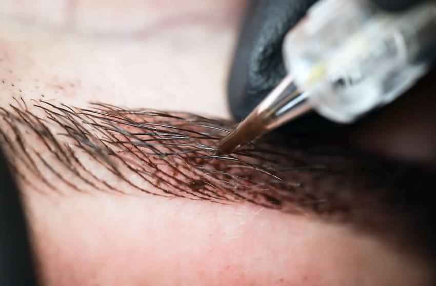 Eyebrow tattooing to create semi permanent fuller brows